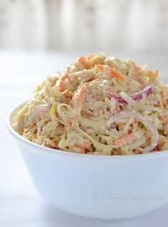 Creamy Coleslaw Serves: 8 Ingredients 4 cups cabbage (white, red or combination of both), finely shredded ½ cup carrot, shredded ¼ cup purple onion, shredded DRESSING: ½ cup mayonnaise ¼ cup sour cream 2 teaspoons Dijon mustard 2 teaspoons apple cider vinegar or lemon juice a pinch of ground cumin (optional) salt and ground black pepper, to taste