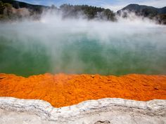 """Soak your feet in the hot springs of Rotorua, a New Zealand city known for its geysers, thermal springs, and bubbling mud pools. It's nicknamed the """"Sulphur City,"""" and visitors can also partake in water sports in the region's many lakes."""