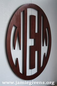 i'm not much of a monogram person but i like this wooden monogram cirlce