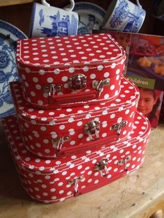 red polka suitcases