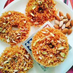 Rajasthani Ghevar Recipe is a round plate-shaped sweet which is made with flour and sugar syrup and deep fried in oil, served during evening as sweet snack Fudge Recipes, Best Dessert Recipes, Tea Recipes, Easy Desserts, Sweet Recipes, Indian Desserts, Indian Sweets, Indian Food Recipes, Ethnic Recipes