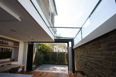 sliding folding doors - open. boxed structural glass rooflight above    www.iqglassuk.com
