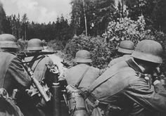 Summer 1942, Eastern Front: German grenadiers riding on armored personnel carriers advance through forests. Note grenadier on left leveling his rifle on the shoulder of his comrade who's carrying leather sheath containing spare barrel for the machine gun. Any discharge of the rifle would cause the front man to go deaf - permanently. Also note the machine gun monopod with swivel for use with the machine gun.