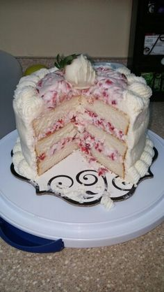 White cake with white chocolate whipped cream, filled with fresh strawberries