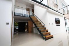 Bespoke Staircase Liskeard was a model with oak treads, glass balustrade and steel stringers. Our famous model 500 system in a straight flght. Modern Staircase, Spiral Staircase, Stair Supplies, Bespoke Staircases, Glass Balustrade, New Builds, New Homes, Stairs, Building