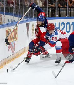 Michal Jordan (L) of Czech Republic and Evgeny Kuznetsov (R) of Russia battle for the puck during the 2016 World Cup of Hockey preparation match between Czech Republic and Russia at O2 Arena Prague on September 10, 2016 in Prague, Czech Republic.
