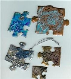 Altered puzzle pieces. These would make cute charms.
