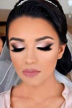 Lovely glam make up with thick and full lashes , dramatic eye shadow and soft pink lipstick which is a perfect match #weddingmakeup