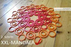 Geo-Mandala mit Kindern auf dem Boden legen mit den Geo-Legespielen nach Fröbel (hier Spielgabe 9, Froebel Gift 9)  -> Tutorial, 2. Schritt fertig Spielgaben - Legespiele kaufen:  http://www.friedrich-froebel-online.de/shop/