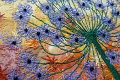 https://flic.kr/p/avkKW3   Autumn Allium, detail   Detail of a piece in progress.  Allium flower-head against an autumn coloured background.  Primarily machine worked with free-motion stitching.  Satin stitch stem, also free-motion. Glass beads, black.