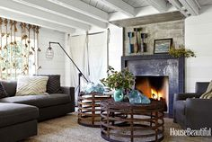 cozy beach house family room.  metal fireplace + planking + organic details | Erin Martin Design
