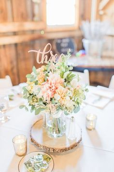 Pastel wedding centerpiece idea - ethereal + rustic wedding centerpiece idea - wood slice base with pastel dahlias + greenery with rose gold, laser-cut table numbers {Thompson Photography Group}