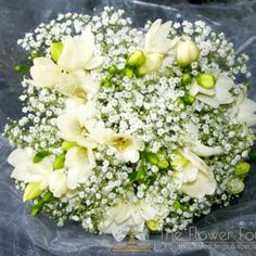 Hand tied bridesmaid bouquet of Million Star Gypsophila and white Freesia - Wedding Flowers by Rhiann.  Stoke on trent staffordshire