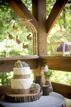Vineyard wedding\winery wedding via Kelly Anne Photography at Sharp Mountain Vineyards | North Georgia  Cakes by Carissa's rustic buttercream cake decorated with burlap and hydrangeas atop a wooden log cake stand.