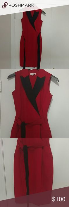 Calvin Klein red Christmas dress. Size2 Very elegant dress reach almost above the knee. Beautiful red and black. Belt made with the same material. You can take off the belt. There is a hidden zipper in the front. Calvin Klein Dresses Midi