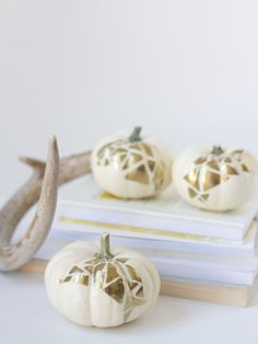 Use gold paint to make this chic geometric pumpkins.