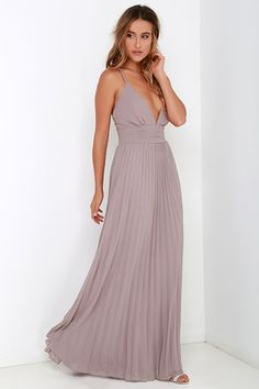 Deeper than the deep blue sea and the Grand Canyon combined ... that's how deep our love for the Depths of My Love Taupe Maxi Dress is! Elegant chiffon in a lovely taupe hue (with lavender undertones) shapes a triangle bodice and sultry V neckline supported by crisscrossing, adjustable spaghetti straps. The fitted, pintucked waistline accentuates your figure before flowing into an accordion pleated maxi skirt. Hidden back zipper and clasp. Fully lined. 100% Polyester. Dry Clean Only…