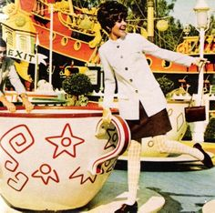 """justseventeen:  March 1968. """"On the Mad Tea Party ride, a suit takes a long-stemmed jacket."""""""