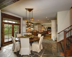 Cute Rustic Round Dining Table Feats White With Stair Lighting Interior Ideas And Natural Stone Flooring Ideas Image