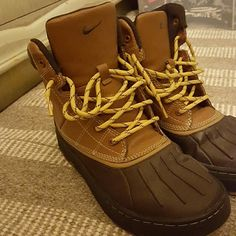 Nike Hiking Boots Hiking boots in excellent condition! I only wore these once because I am a 7.5 in womens and can usually wear a 6 in kids. However, these were a little snug. Would definitely fit a womens size 7.  Offered through the brand's All-Conditions Gear collection, this winter boot features rubber soles with lug treads for excellent traction. The synthetic leather upper is low-maintenance, making these boots appropriate for hikes and everyday wear. Nike Shoes Winter & Rain Boots