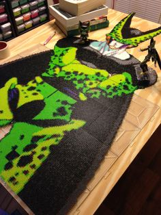 Cell Dragon Ball perler project ( 6 foot 10 inches, 50k+ Perler beads and 70 pegboards) by  Ellsworth-Toohey - More: http://imgur.com/a/P025J