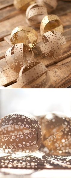 these are fabulous!! Punched Paper Balls -- string together for an awesome DIY garland that can be used almost any time of year | this heart of mine