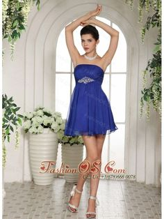 Peacock Blue Empire Beading 2013 Prom Dress With Mini-length- $95.48  http://www.fashionos.com  This short prom gown is made of a great tulle fabric and features a strapless bodice and a straight neckline. The midsection of the dress is cinched with sparkling beads. The A-line pleated skirt is slightly gathered, which allows you to move beautifully with you when you walk. A zipper up closure secures the dress in place. Just a cute little dress for any event on your calendar!