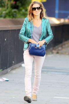 September 24 2012 For a day out in New York, she wore a metallic blue jacket with white jeans and a striped T-shirt, accessorised with grey ballerina flats and a cobalt Jason Wu handbag.