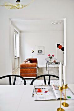my scandinavian home: Knoll Bertoia Diamond chair, Arne Jacobsen 7 chair and Hans Wegner Wishbone (or 'Y') chairs, cognac coloured Charles le Corbusier LC