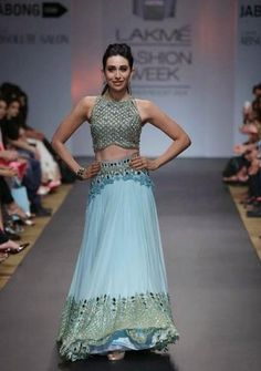 <p>Karisma walked the ramp during Lakme Fashion Week 2014, in a beautiful aquamarine Arpita Mehta ensemble. The crop top with mirror work and <em>lehenga </em>with 3D floral embroidery looked simply stunning. And, we totally loved the way she completed her look with a neat pulled back hairdo and minimal makeup.</p>