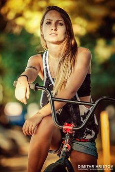 Young girl riding BMX bicycle Photography by Dimitar Hristov - 54ka active activity beautiful Beauty bicycle bike biker bmx caucasian cute cycling dress Fashion female girl glass green happy holiday leisure lifestyle lovely Nature outdoor people person portrait pretty Ride rider road sport spring summer sunny travel tree trip urban white