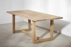The refectory-style contemporary table is offered in two standard sizes and made from solid oak. Its simple design and clean lines work in various settings.