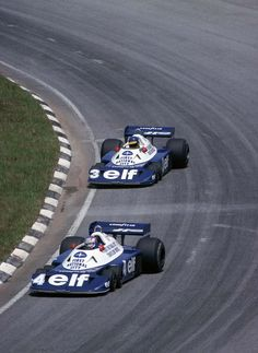 Patrick Depailler and Ronnie Peterson on the Tyrell P34 Cosworth, Interlagos 1977 - note the drift angle
