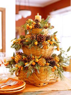 Fall Centerpiece --baskets, clove-studded oranges, pine cones, candles.
