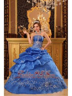 Elegant Blue Quinceanera Dress Strapless Organza Beading Ball Gown  http://www.fashionos.com A stunning quinceaneara dress for those occasions when you really want to 'wow' the crowd! Top bodice with lace-up back is completed with embroidery and beadings throughout a beaded embroidery band Creates the illusion of a fuller bust line. The long-length skirt is made from many tiers of peek-a-boo layer fabric, which are embellished with embroidery.