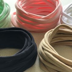 Expanded range of popular 26cm newborn Nylon elastic headbands.   Available in Nude, Black, White, Mint, Pale Pink, Ivory, Mustard, Wine Red and Royal Navy