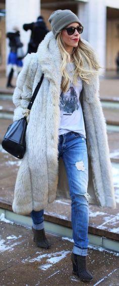 Shop this look on Lookastic: http://lookastic.com/women/looks/beanie-sunglasses-ankle-boots-boyfriend-jeans-crew-neck-t-shirt-crossbody-bag-fur-coat/5504 — Grey Beanie — Black Sunglasses — Navy Studded Suede Ankle Boots — Blue Ripped Boyfriend Jeans — White and Black Print Crew-neck T-shirt — Black Leather Crossbody Bag — Grey Fur Coat