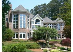 Custom built home with floor-to-ceiling windows that showcase the panoramic lake views in Greensboro, GA. Listed for $2,385,000.