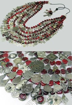 by Marrakech jewel designer Faouzi   Multi stranded piece has a plethora of beautiful Moroccan pendants which have been strung with many wonderful red glass Czech Hajj beads.