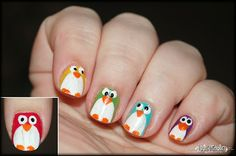 Penguin Skittles nails.  It's a fail since she used acrylic paint (as she says), but it's a super cute design!