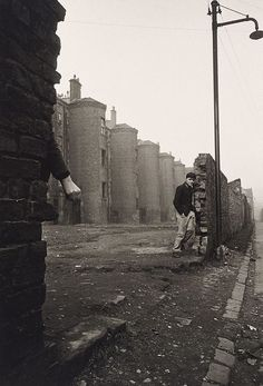 Lewis Morley Gorbals, Glasgow, 1964 Amazing photo showing the round stairwells leading into the tenements, I have never seen this before, interesting architecture.