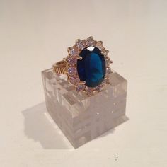 Blue stone gold cocktail ring   Blue stone gold cocktail ring  size ~7NO TRaDES/PP Unmarked ❄️ Jewelry Rings