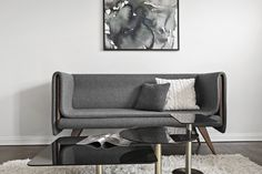Sofa designed by Seer. Pillows H&M Home. Coffee table Tom Dixon. Wool carpet Ikea.