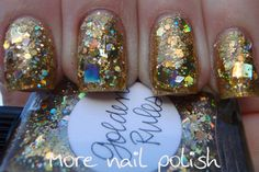 Golden Rules  This was two wiped coats (but with some brush giggling to get nice placement of the big glitters) over Milani 3D, the gold scattered holo polish. The formula was good and all the glitters were very well behaved and lay perfectly flat with no curling at all.