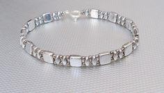 silver bracelet czechmate beads beaded bracelet beadwork by beadnurse on Etsy https://www.etsy.com/listing/217479370/silver-bracelet-czechmate-beads-beaded
