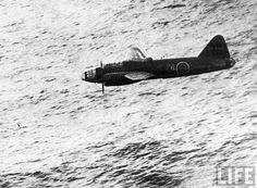 LOW PASS Bomber Japanese Mitsubishi G4M flying a few meters above the water, July 1945