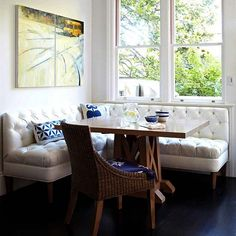 Breakfast nook with Victoria Hagan table. Check out Ballard Designs for their bench seating including dozens of fabric choices and storage options (wait for 15% off discounts). Sooo comfy for meals. Guests love the coziness, too!