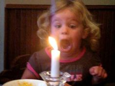 Girl Struggles To Blow Out Candle