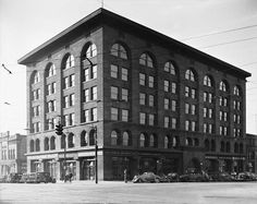 The Dooly Building, December 24, 1936. This structure was one of Salt Lake's most important architectural landmarks. It was designed by Chicago architect Louis Sullivan and built of local red sandstone in 1892. The strong arches and selectively placed geometric detailing are typical of Sullivan's work. The landmark was demolished in 1964, and the site on the southwest corner of West Temple and 200 South was more recently been occupies by the Shilo Inn.
