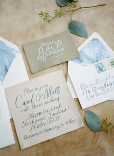 Leather invites and watercolor envelope liners, wedding stationery calligraphy by Oh My Deer Handmades